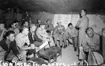 Inspecting North African bases, Winston Churchill attends a USAAF 414th Bombardment Squadron briefing at Chateau-dun-du-Rhumel Airfield, Algeria, 31 May 1943; note Brooke, Marshall, Eden