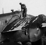 Crew member sweeping ashes off a B-25 of the 340th Bomb Group at Pompeii Field, Italy. Ash came from an eruption of Mt Vesuvius on 23 Mar 1944 that rained hot ash and brimstone on the area damaging several aircraft. Photo 1 of 2.