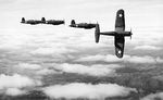 Four F4U Corsair fighters practicing aerial maneuvers, Mar-May 1943; probably stateside training. Photo 2 of 2.