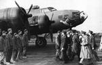 "King George VI of Great Britain visits the base of the USAAF 352nd Bomb Squadron at Chelveston, England, UK, 13 Nov 1942. The aircraft is B-17F ""Holey Joe"" with Cpl David C Casteel of Illinois standing second from the left"