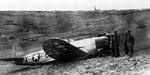 P-47D Thunderbolt of the 367th Fighter Squadron made a belly landing in field artillery position after being hit in the left wing during a dive bombing attack on near Würzburg, Germany, 1 Apr 1945.  The pilot was only slightly injured.