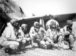 "Pilots of the ""Tuskegee Airmen,"" 332nd Fighter Group in front of P-51C ""Skipper's Darlin' III"" flown by Capt Andrew Turner (2nd from right), at Ramitelli, Italy, 1 Aug 1944. Photo 1 of 2."