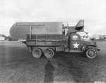 Piper L-4 Grasshopper observation aircraft on a 2.5 ton CCKW truck in preparation for the D-Day landings. Devon, England, United Kingdom, Feb 12 1944.