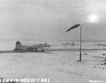 B-17G Fortress with the 327th Bomb Squadron taxis for take-off at snow covered RAF Podington, Bedfordshire, England, UK for a morning mission to Gymnich Airfield; Jan 10 1945