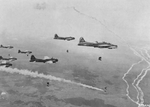 B-17G Fortresses of the 546th Bomb Squadron drop their loads on the rail yards at Elsterwerda, Germany, Apr 19 1945. Note the smoke marker dropped by the lead aircraft signaling the remaining aircraft to drop their bombs.
