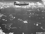 "B-24J Liberator ""Kansas Cyclone"" of the 26th Bomb Squadron approaching targets in and around the Truk Lagoon, Caroline Islands, 1944. Note Udot Island below."