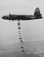 "B-26B Marauder ""Shootin' In"" of the 556th Bomb Squadron releasing its bomb load, 1944-45"