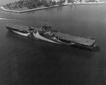 Newly commissioned USS Ticonderoga moves down the Elizabeth River from the Norfolk Navy Yard to the deperming crib, Portsmouth, Virginia, United States, May 30 1944; note camouflage Measure 33 Design 10A