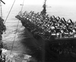 Escort Carrier USS Attu refueling at sea while transporting F4U Corsairs and SB2C Heldiver aircraft, Sep 3 1945