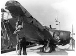 "US Sailors examine wreckage of Japanese Aichi D3A ""Val"" dive bomber that crashed during Pearl Harbor attack, Dec 1941"