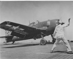F6F-5 Hellcat set for a catapult launch from Escort Carrier USS Kasaan Bay in support of Operation Anvil/Dragoon, the invasion of southern France, Aug 1944