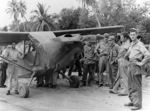 "L-5 Sentinel ""Bouncing Betty"" of the 25th Liaison Squadron in New Guinea. Sgt pilots of the ""Guinea Short Line"" rescued downed fliers and guided fighters to concealed jungle targets. SSGT Jim Nichols standing by the pilot's door"