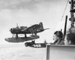 US Navy Lt Fred Hunter piloting an OS2U-3 Kingfisher of Cruiser Scouting Squadron 1 as it is catapulted off the cruiser USS Detroit in the Aleutians, 1943-44