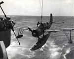 OS2U Kingfisher scout plane being recovered aboard the battleship USS Missouri, 1944-45