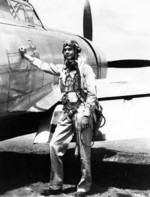 Col Benjamin O Davis, Commanding Officer of the 322nd Fighter Group, stands next to his P-47 Thunderbolt fighter, date and location unknown