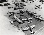 Maintenance area servicing P-51 Mustangs and one P-47 Thunderbolt of the 35th Fighter Group, Lingayen Airfield, Luzon, Philippines, Apr 1945