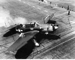 SB2C-1C Helldiver of Bombing Squadron 2 has its landing gear tangled in the arresting cables after a landing on USS Hornet (Essex-class), Mar-Sep 1944.