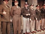 BGen Jesse Auton, Gen Eisenhower, LGen Carl Spaatz, MGen James Doolittle, MGen William E Kepner, Col Donald M Blakeslee, Apr 11 1944. VIPs were present for the presentation of Blakeslee with the Distinguished Service Cross, RAF Debden, Essex, England, UK