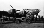 "A Jeep brought litters to the B-17F Fortress ""The Old Man"" of the 65th Bomb Squadron shortly after landing at Dobodura, New Guinea, Mar 8 1943. The B-17 was attacked by 13 Japanese fighters during a photo-recon mission over Gasmata, New Britain"