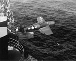 F6F-3 Hellcat of Fighting Squadron 2 being shot from the hangar deck catapult of the Fleet Carrier USS Hornet (Essex-class) during training in Chesapeake Bay, Feb 12 1944.
