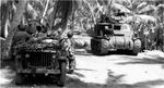 M3 Lee Medium Tank, with a 75mm gun in the sponson and a 37mm gun in the turret, on Butaritari Island, Makin Atoll, Gilbert Islands, Nov 1943. A medical crew waits beside their jeep for tanks to pass.