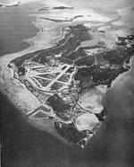 Aerial view of Peleliu in Oct 1946.  Many facilities have been built and the jungle growth has returned to the coral island since the fierce fighting of 1944 stripped it bare.  Even so, the contours of the Umurbrogol Mountains can easily be seen.