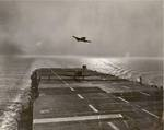 One SNJ Texan has just landed on USS Sable on Lake Michigan, United States as another goes around for another pass, 1943.