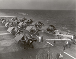 One SNJ Texan and 13 FM-2 Wildcats tied down on the flight deck of training aircraft carrier USS Sable on Lake Michigan, United States, 1944.