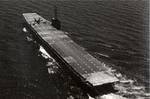 An aircraft nosed over on the flight deck of training aircraft carrier USS Sable on Lake Michigan, United States, 1944.