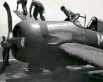 Crews move to secure an FM-2 Wildcat after a hard landing on the training aircraft carrier USS Sable on Lake Michigan, United States, 1945.