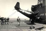 An FM-2 Wildcat after a very hard landing aboard the training aircraft carrier USS Sable on Lake Michigan, United States, 1943-45. Note the broken tailhook, the missing tail wheel, and the mangled wingtip.