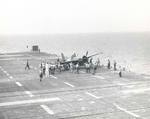 An FM-2 Wildcat appears to have damaged its landing gear in a hard landing aboard the training aircraft carrier USS Sable on Lake Michigan, United States, 1944-45.