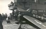Deck crews secure a damaged FM-2 Wildcat following a hard landing aboard the training aircraft carrier USS Sable on Lake Michigan, United States, 1943-44.