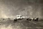 Deck crews aboard the training aircraft carrier USS Sable man lines to right an FM-2 Wildcat that had nosed completely over. Lake Michigan, United States, 1943-45. Photo 1 of 3.
