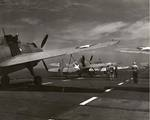 An SNJ Texan, an F4F Wildcat, and a TBF-1 Avenger tied down on the flight deck of the training aircraft carrier USS Wolverine on Lake Michigan, United States, 1943.