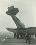 An SNJ-3C Texan noses over just before reaching the edge of the flight deck aboard the training aircraft carrier USS Wolverine on Lake Michigan, United States, 1943.