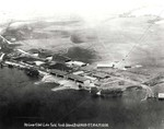 Aerial photo of the seaplane hangars and ramps at Luke Field on Ford Island in Pearl Harbor, Hawaii, early 1920s.  Note the empty island center and opposite shore.