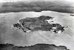Ford Island in Pearl Harbor, Hawaii looking East.  The Army's Luke Field facilities are at left and the Navy's Air Station at right, Mar 25, 1925.