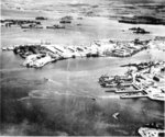 Southeast Loch of Peal Harbor Naval Base, Oahu, Hawaii, Oct 13 1941. The Submarine Base finger piers (right), Supply Depot (center), last 2 berths of Battleship Row (upper left), and East Loch anchorage (upper right).