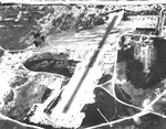 Aerial view looking toward the sea at Bellows Field, Oahu, Hawaii, Oct 27, 1941. The airplanes on the ramp are probably O-47 Observation Aircraft of the 86th Observation Squadron.