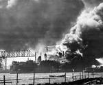 Floating Drydock YFD-2 with destroyer Shaw in flames following the explosion in Shaw's forward magazine, Pearl Harbor, Oahu, Hawaii, Dec 7, 1941.