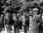 "Gen ""Hap"" Arnold, Gen Dwight Eisenhower, MajGen ""Cowboy Pete"" Corlett (helmet), Gen George Marshall, LtGen Omar Bradley (pointing), and Adm Ernest King visit the guns moved from Pt du Hoc, Normandy, France, Jun 12, 1944."