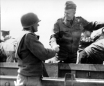 US Army Chief of Staff, Gen George Marshall shakes hands with another officer during his tour of the Normandy beachhead, Normandy, France, Jun 12, 1944.  Note Gen Eisenhower behind Marshall.
