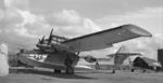 PBY-5A Catalina and F6F Hellcat on the pad at Naval Air Station Alameda, California, United States, 1947. Note that the Hellcat's engine has been removed.