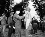 General Bernard Montgomery pins the British Military Medal on the uniform on T/Sgt Philip Streczyk of the US First Division for extraordinary gallantry on Omaha Beach, Normandy, France, on D-Day.  Award presented Jul 7 1944.