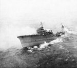 Japanese cruiser Kashii sinking by the stern after being attacked by United States carrier aircraft off the coast of French Indochina (Vietnam) north of Qui Nhon, Jan 12, 1945. Photo 4 of 9