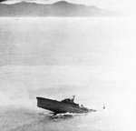 Japanese cruiser Kashii sinking by the stern after being attacked by United States carrier aircraft off the coast of French Indochina (Vietnam) north of Qui Nhon, Jan 12, 1945. Photo 5 of 9
