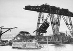 Floating crane YD-25 raising USS Arizona's foremast during salvage operations in Pearl Harbor, Oahu, Hawaii, circa 1943. Note the guns of Arizona