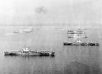British aircraft carriers Victorious, Formidable, Unicorn, Indefatigable, and Indomitable, comprising the carrier component of Task Force 57, at anchor in Leyte Gulf, Philippines, Apr 1945.