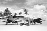 USMC LTs Don Wilson & Gene Youngs of VMF-122 run up their F4U-1D Corsairs prior to receiving an arriving dignitary on Peleliu, Western Caroline Islands, Pacific, Aug 1945.